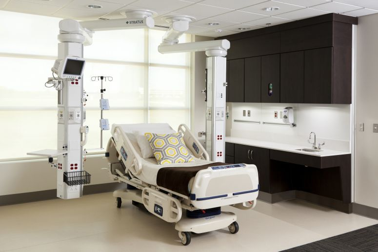 Ceiling-mounted medical pendant / articulated / with column Stratus™ Modular Services Company