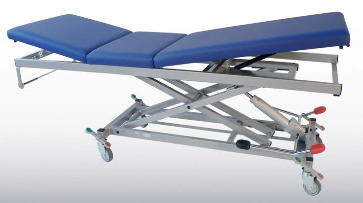 Electro-hydraulic examination table / on casters / height-adjustable / 3-section 2650-00 K.H. Dewert