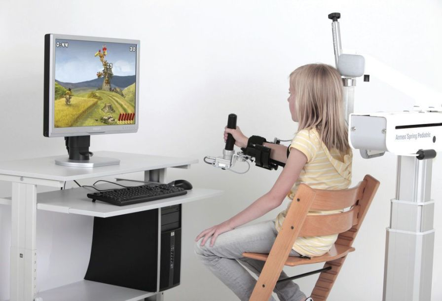 Hand rehabilitation system / arm / pediatric / computer-based ARMEO® SPRING PEDIATRIC Hocoma