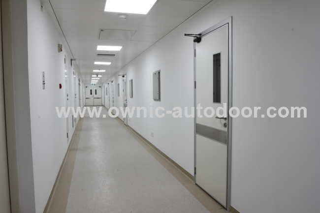 Hospital door / swinging / stainless steel QTDM OWNIC
