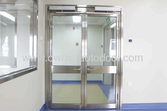 Hospital door / sliding / stainless steel / glass OZP01 OWNIC