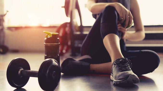 a man resting after a workout
