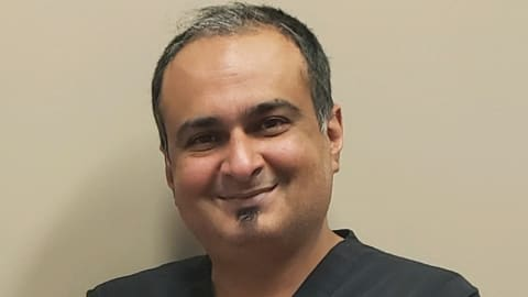 Dr. Javed, DDS