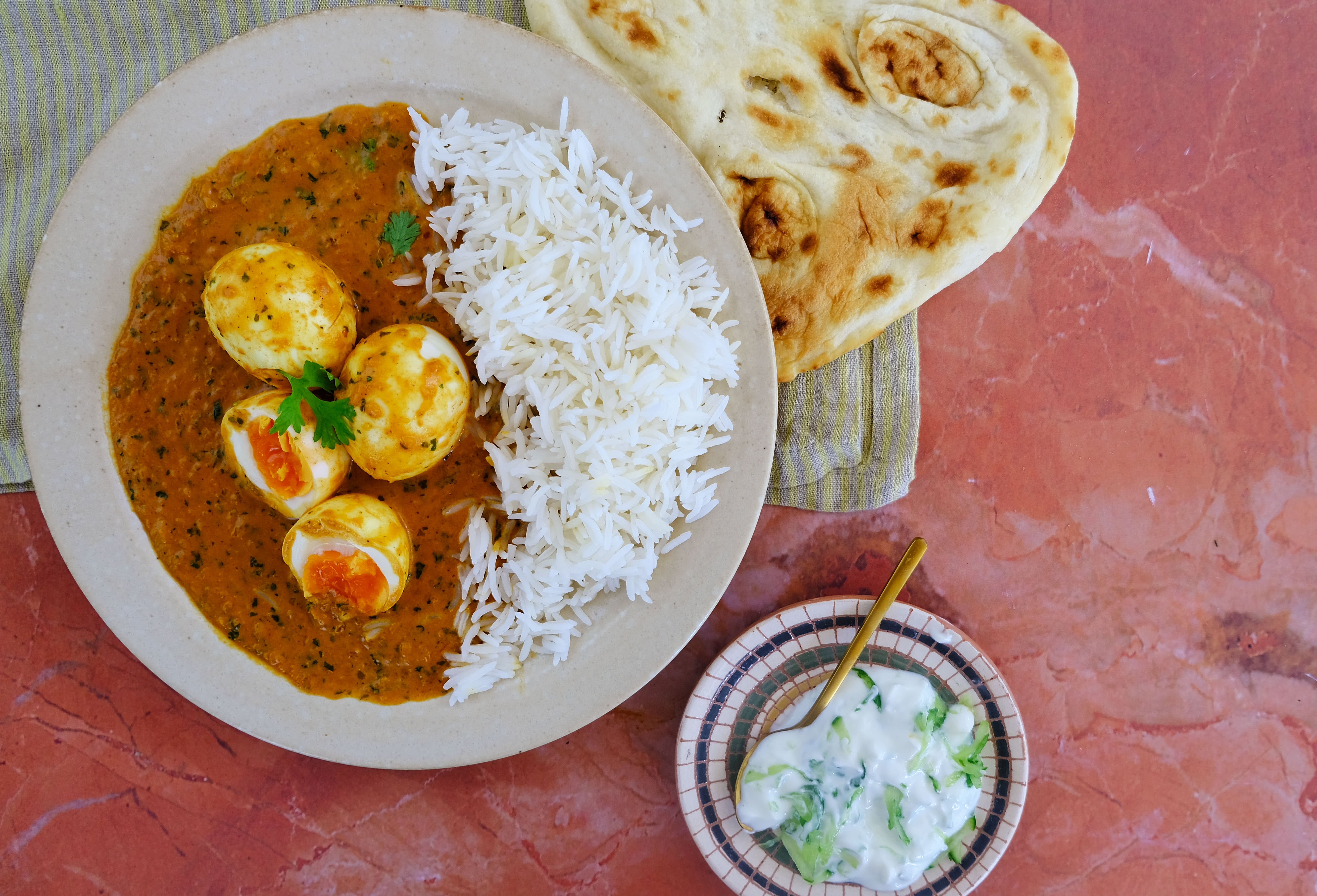 Spicy Egg Curry with Basmati Rice, Naan and Cucumber Raita