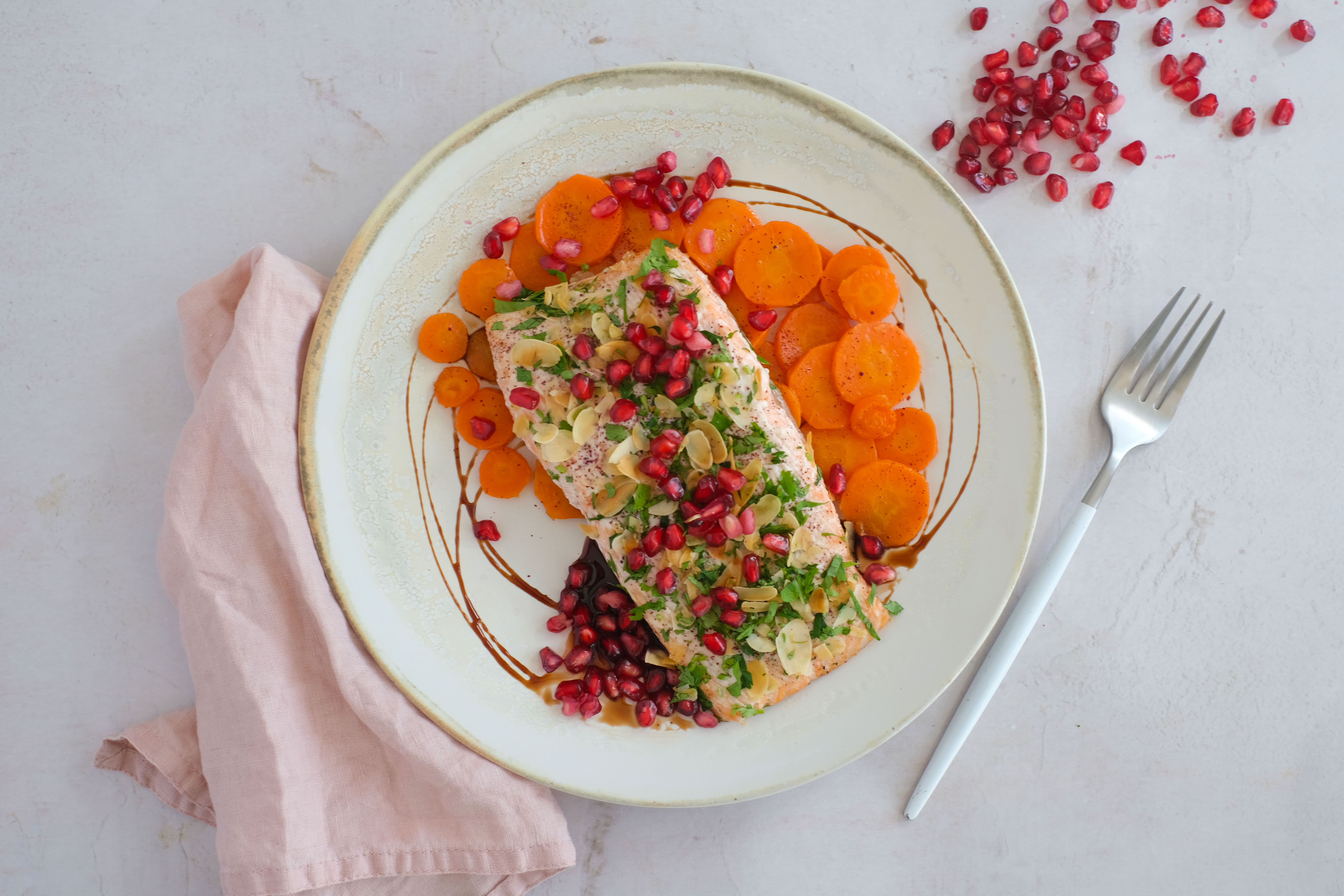 Herby Tahini and Pomegranate Salmon with Glazed Carrots