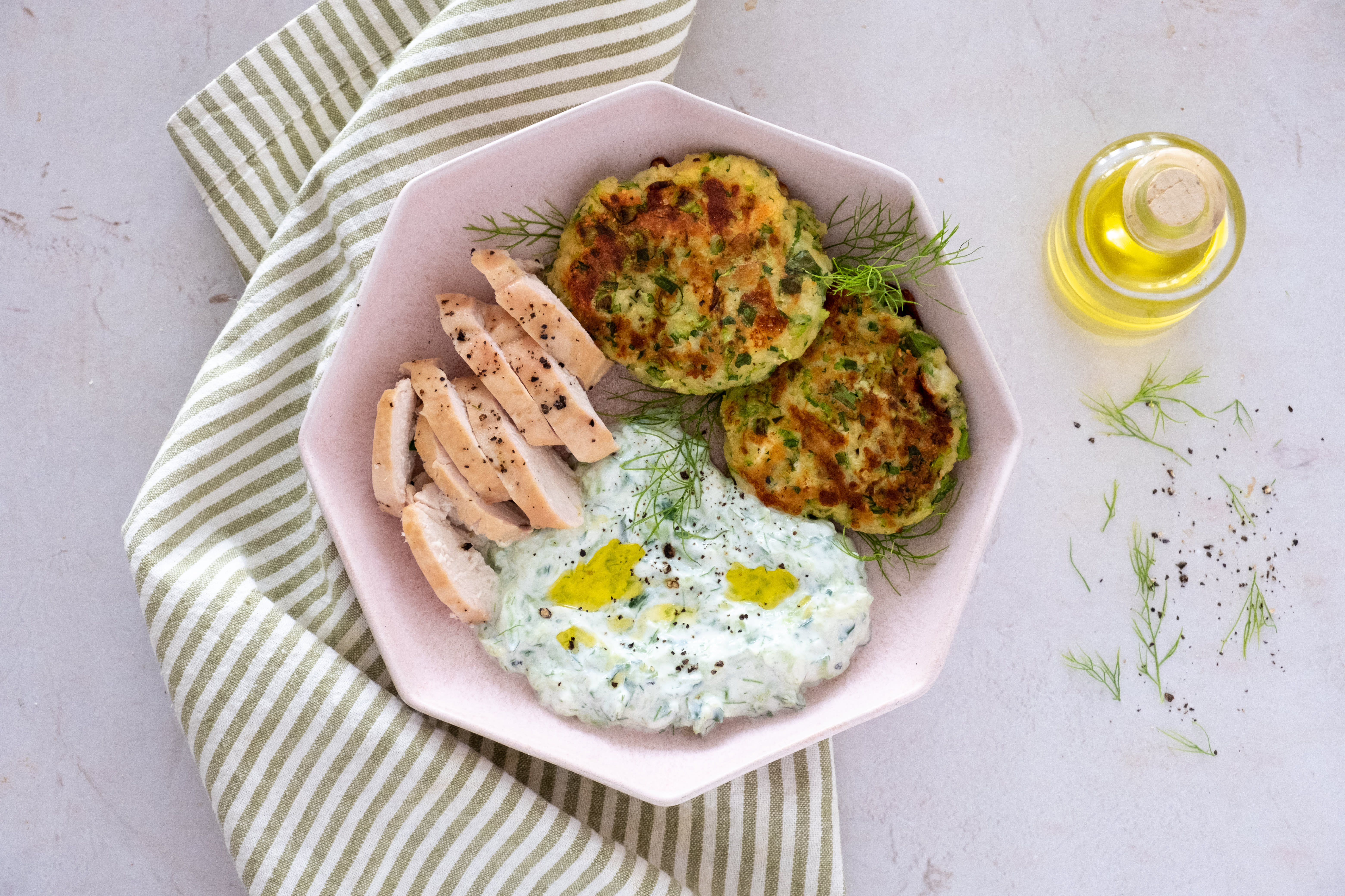 Mediterranean-style Grilled Chicken with Zucchini Fritters and Tzatziki