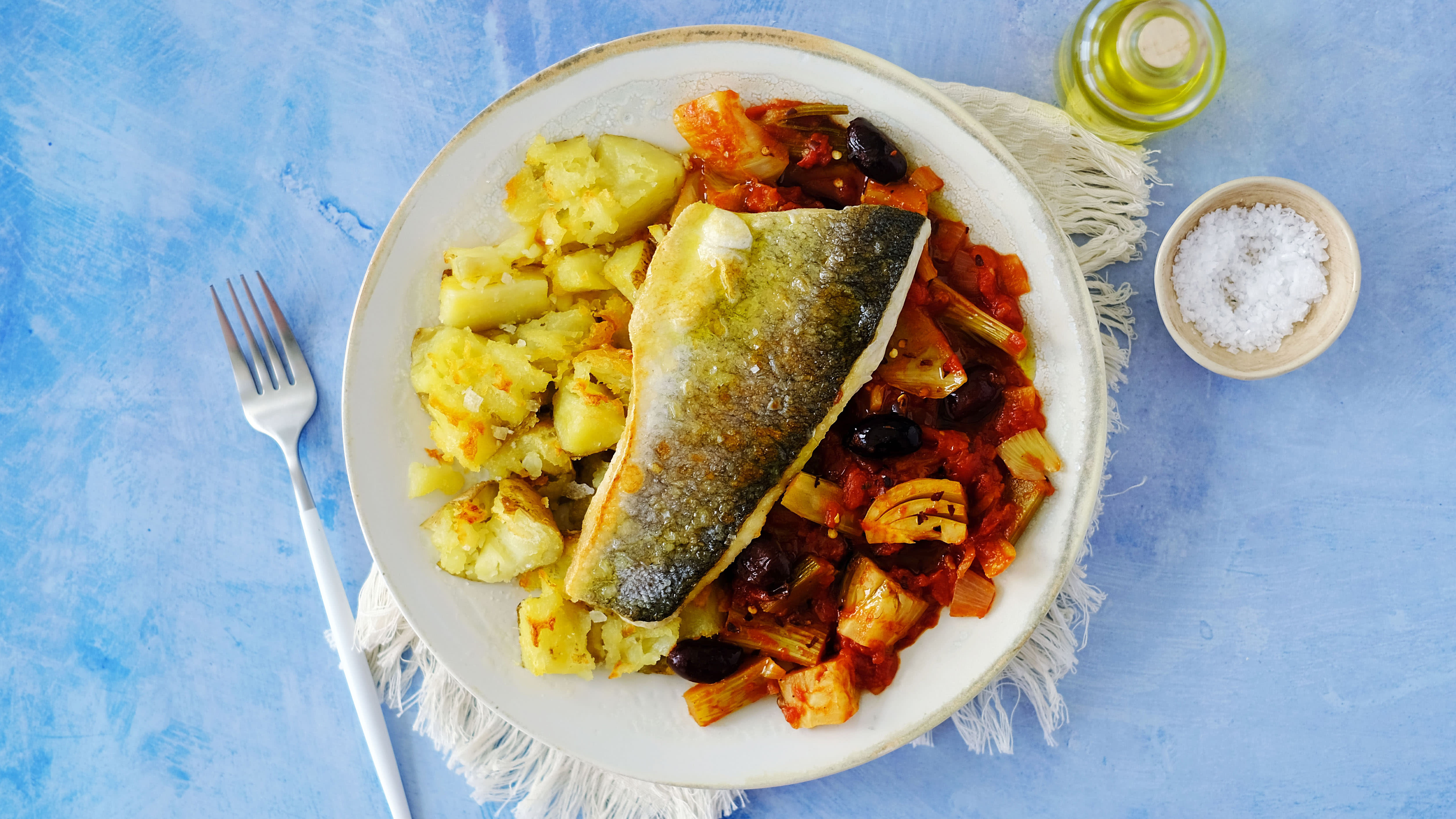 Sea bass with Mediterranean Fennel and Tomato Stew and Crushed Potatoes