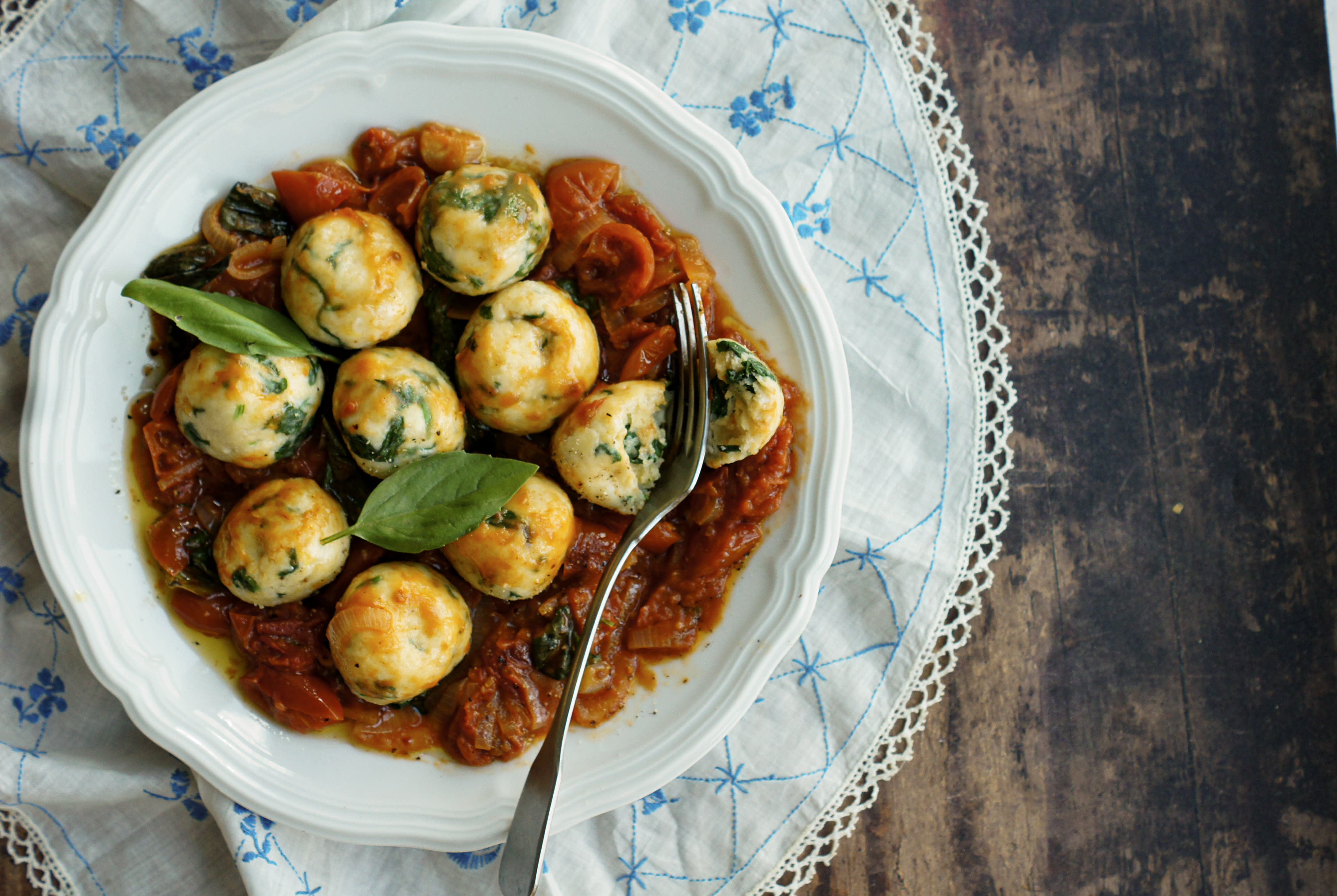 Spinach and Ricotta Gnudi in Buttery Tomatoes
