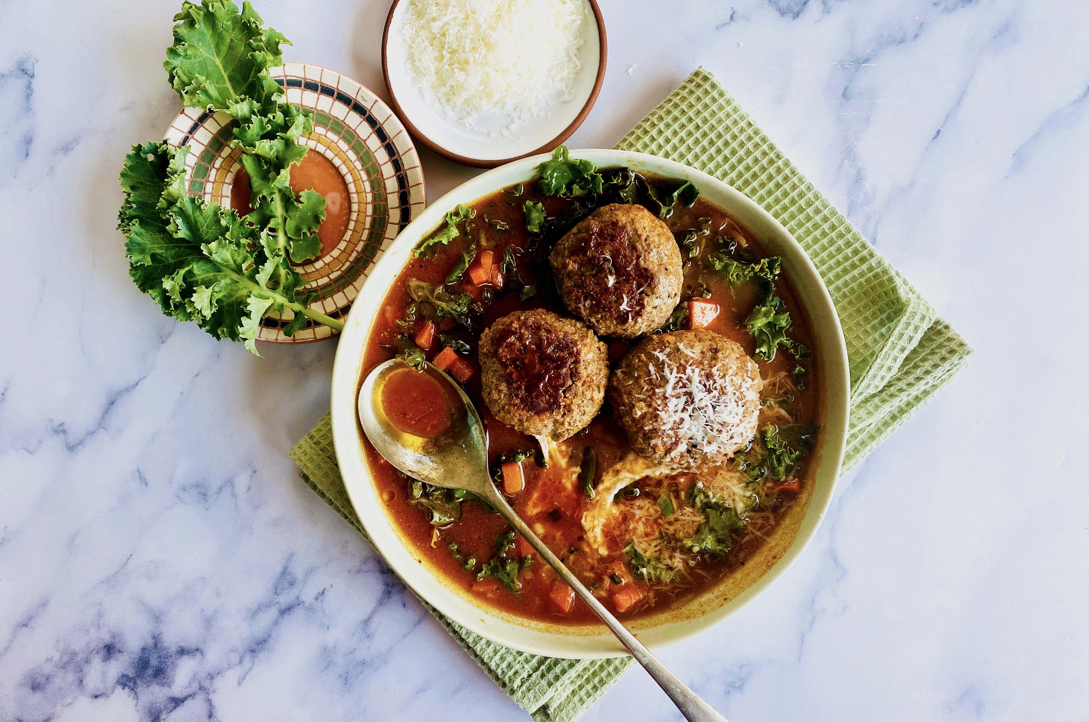 Mozzarella-Stuffed Meatballs in Tomato Broth with Kale