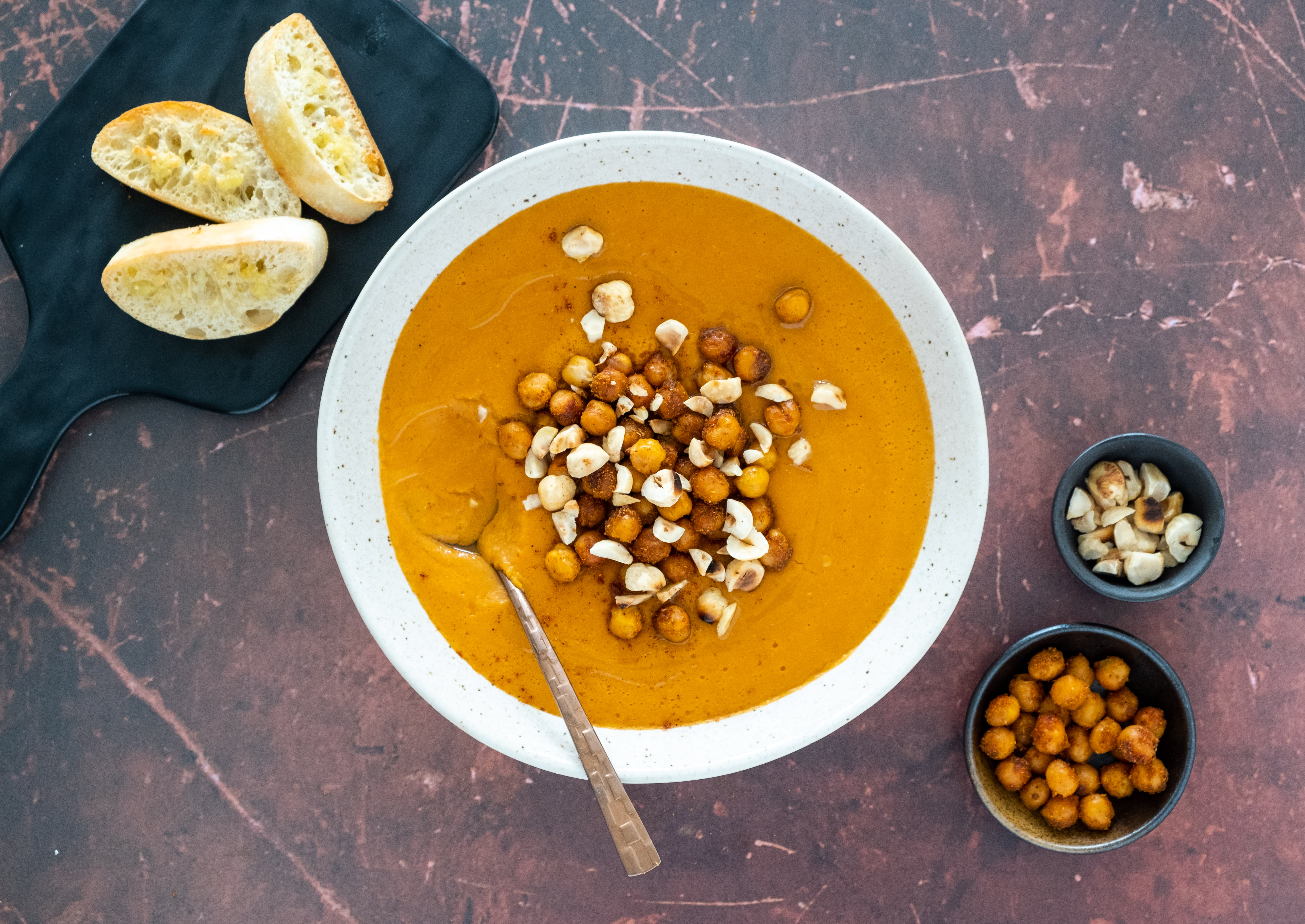Fiery Red Curry Lentil Soup with Crispy Chickpeas and Hazelnuts