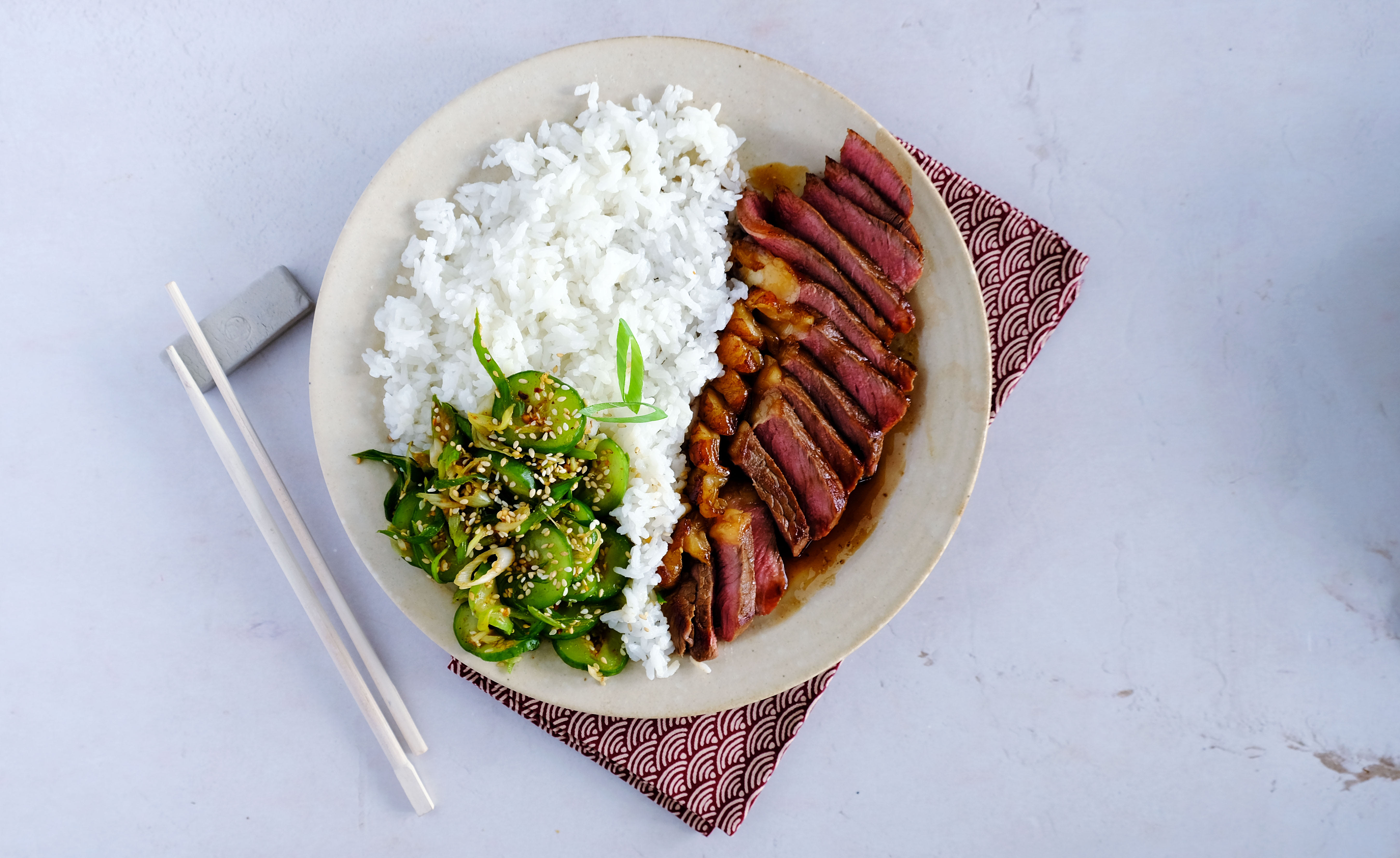 Soy-Glazed Steak with Cucumber Salad and Rice