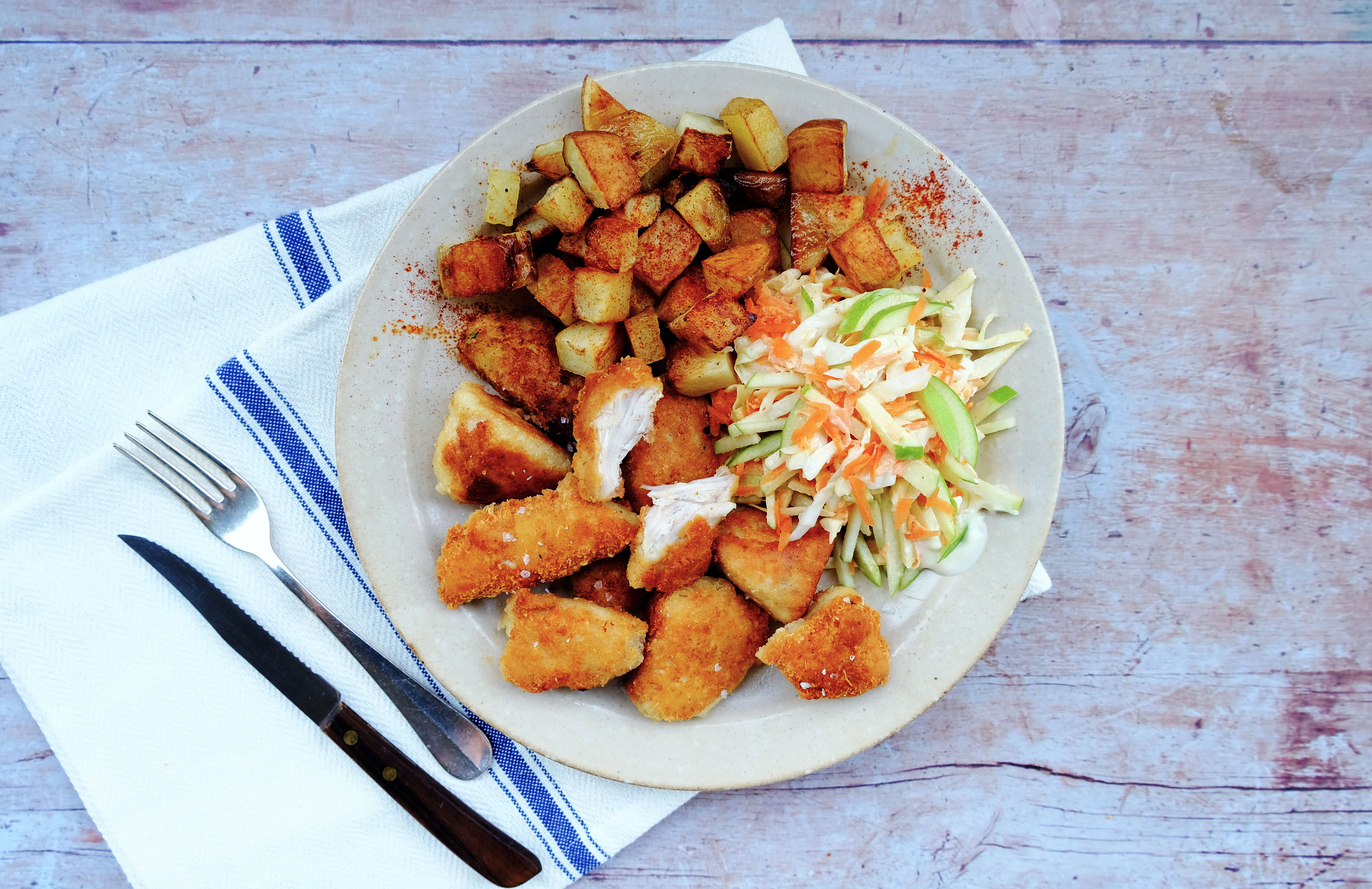 Parmesan Chicken Nuggets with Potato Cubes and Slaw