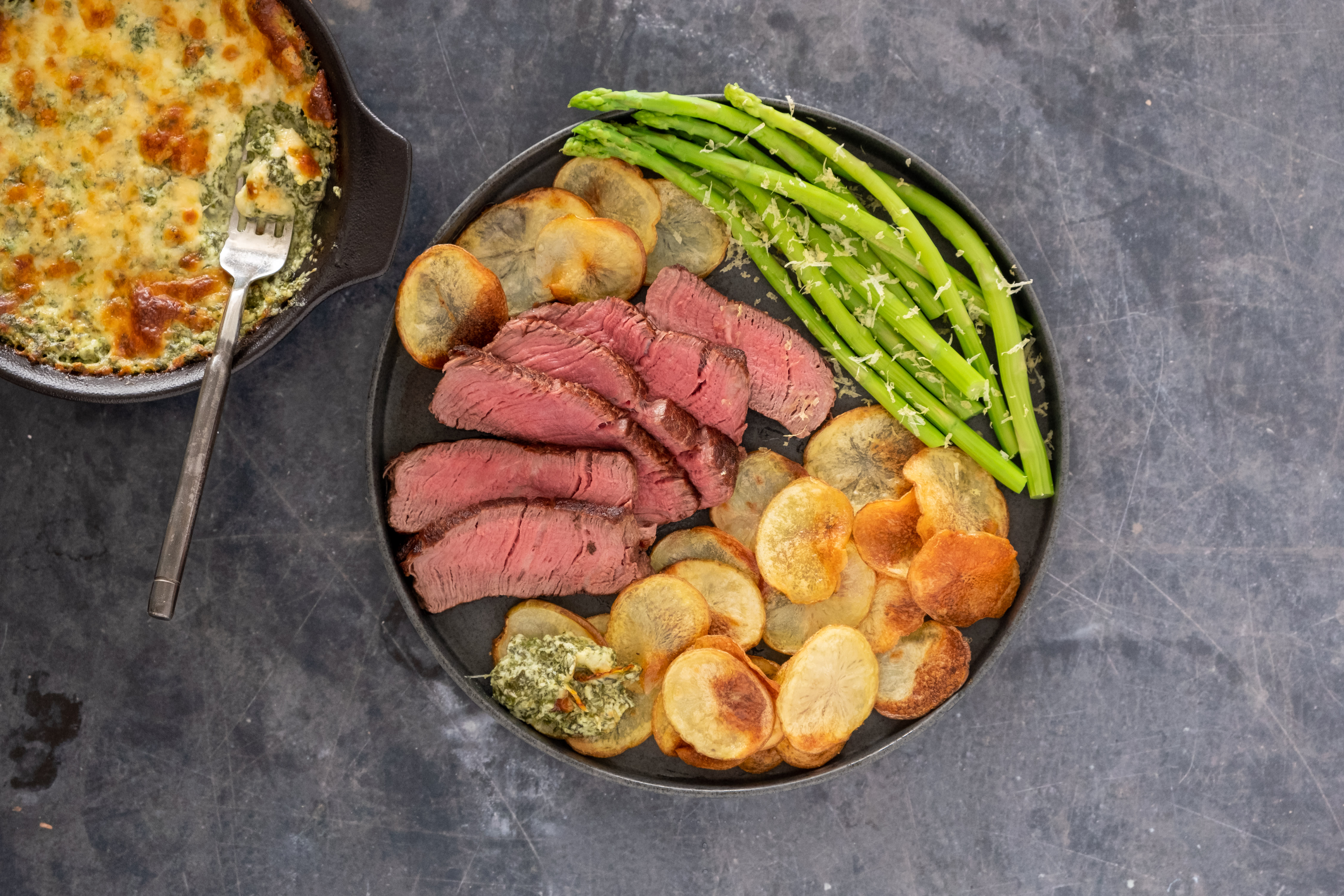 9 oz Fillet Steak and Cheesy Spinach Dip with Roasted Potato Discs and Asparagus
