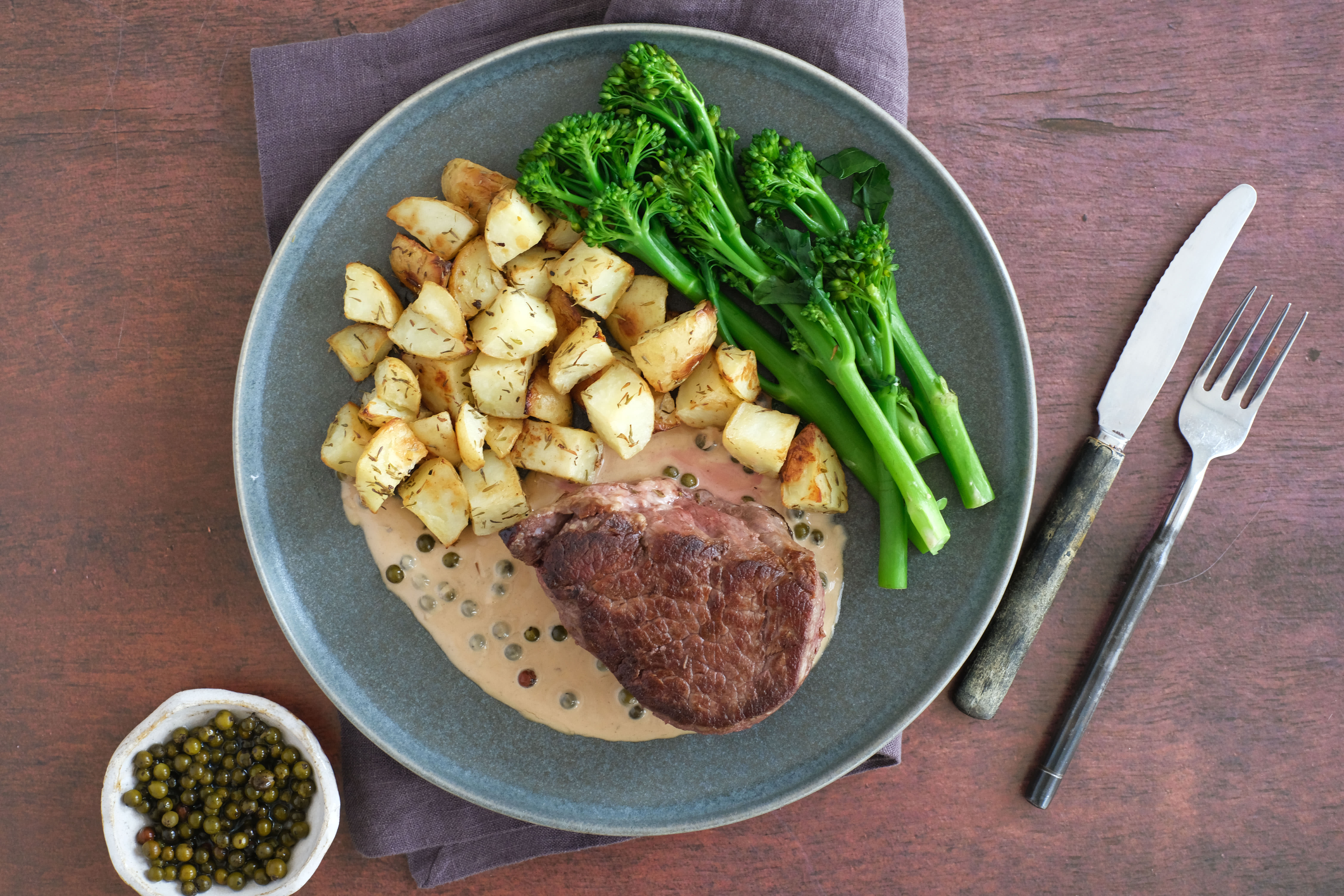 Fillet Steak with Broccolini, Roasted Baby Potatoes and Green Peppercorn Sauce