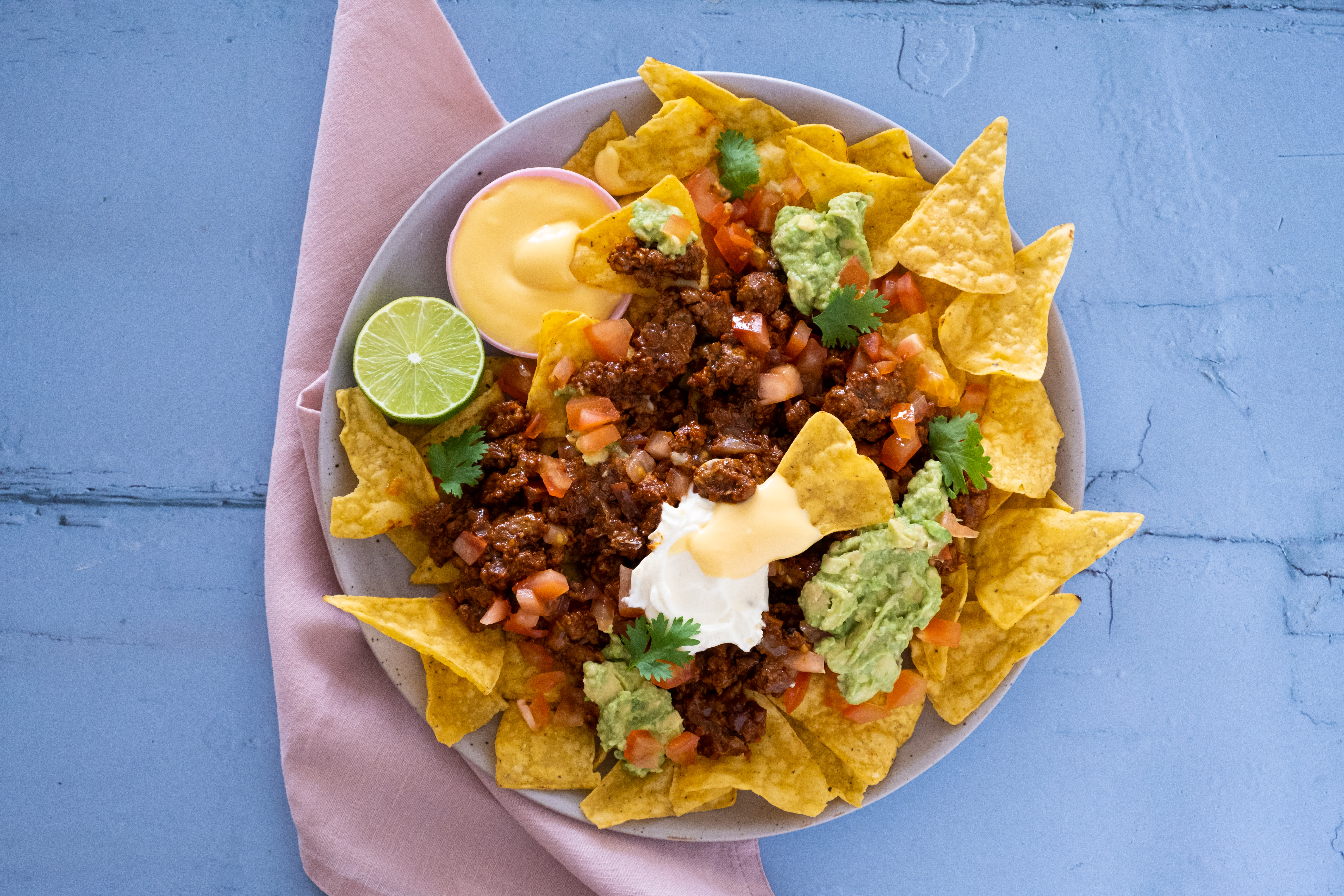 Loaded Beef Nachos with Cheddar Cheese Sauce and Avocado