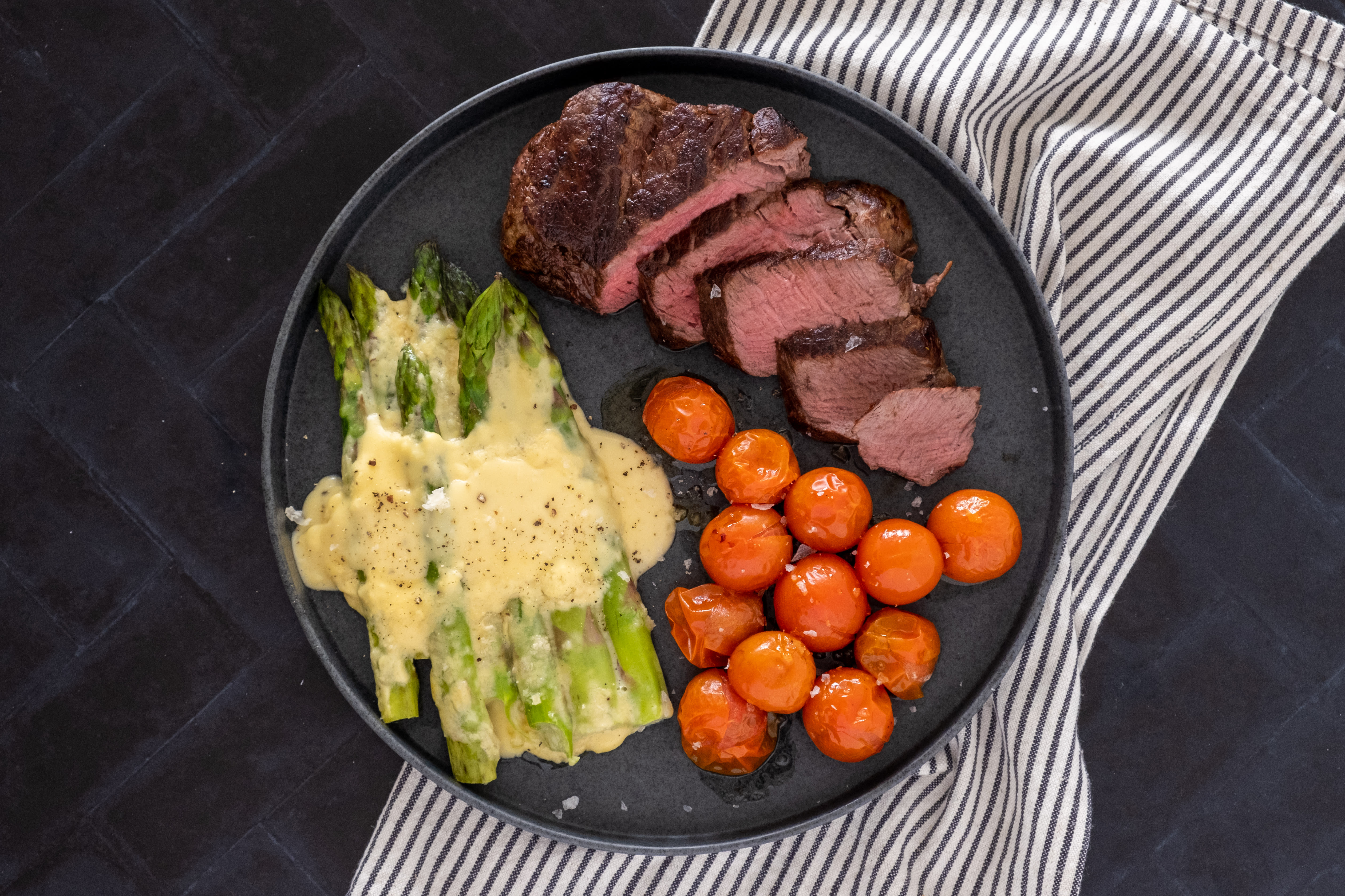 9oz Fillet Steak with Baked Asparagus Cheese and Cherry Tomatoes