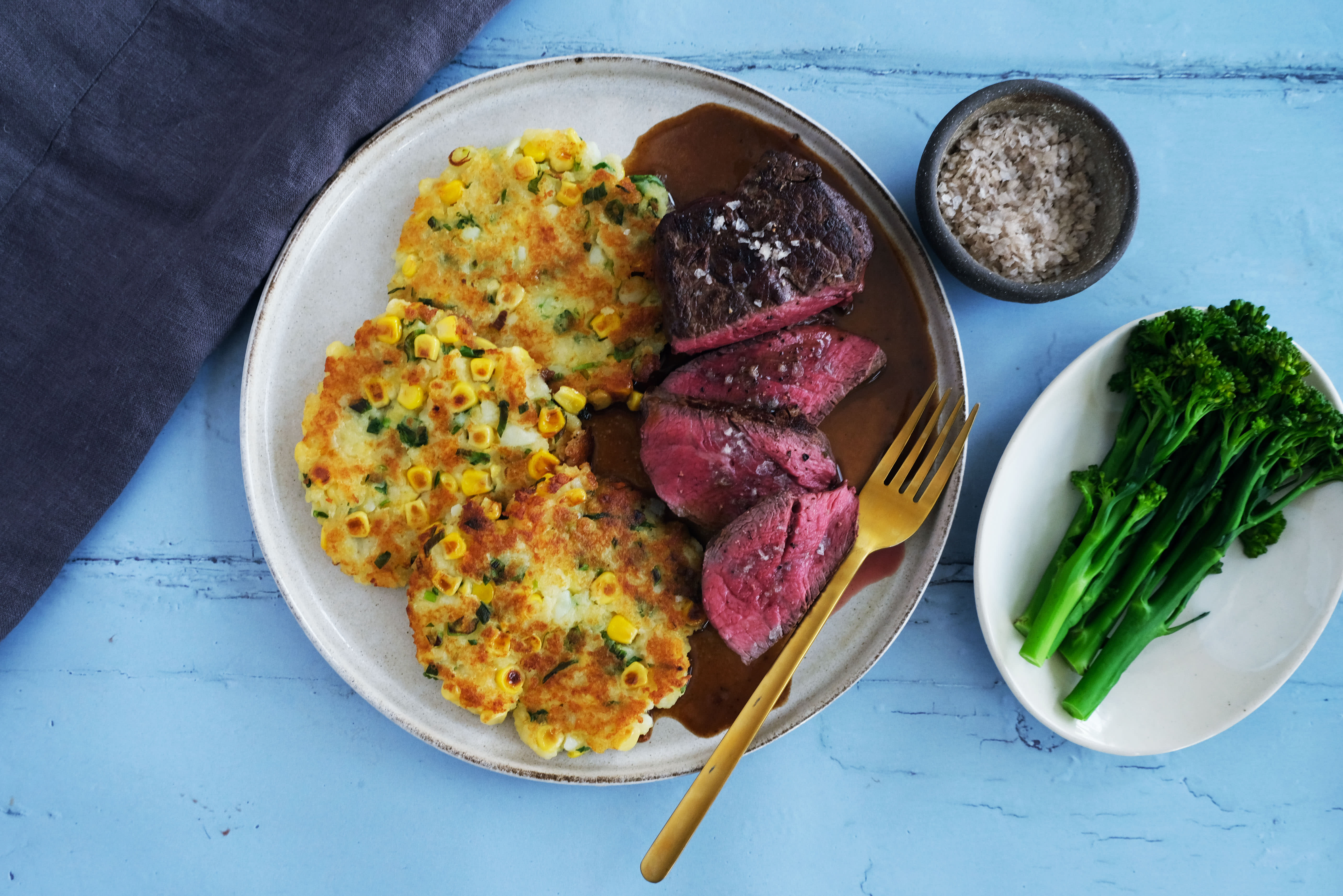 9 oz Beef Fillet with Potato Corn Cakes and Broccolini