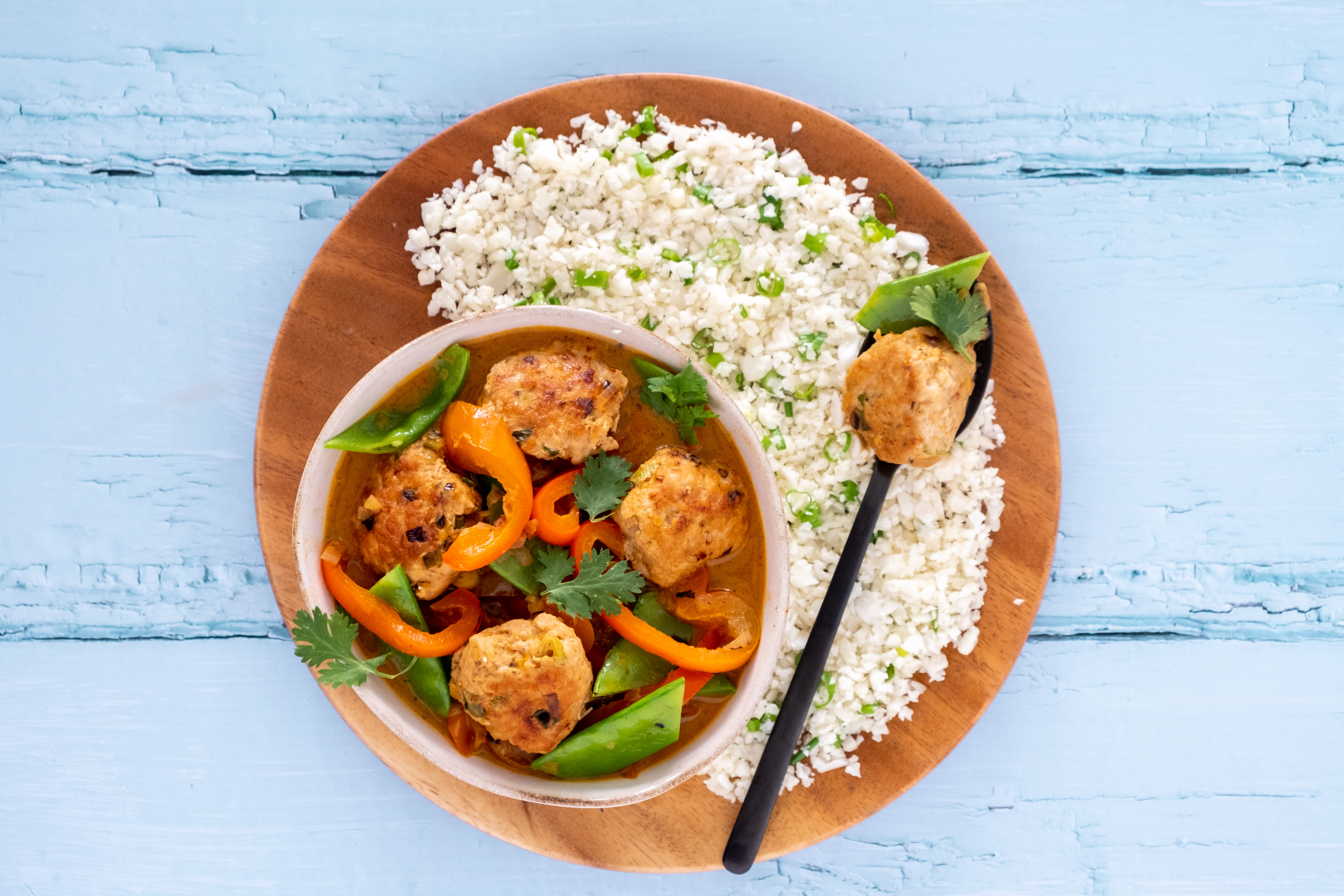 Spicy Thai Chicken Meatballs in Creamy Red Curry Sauce with Cauliflower Rice