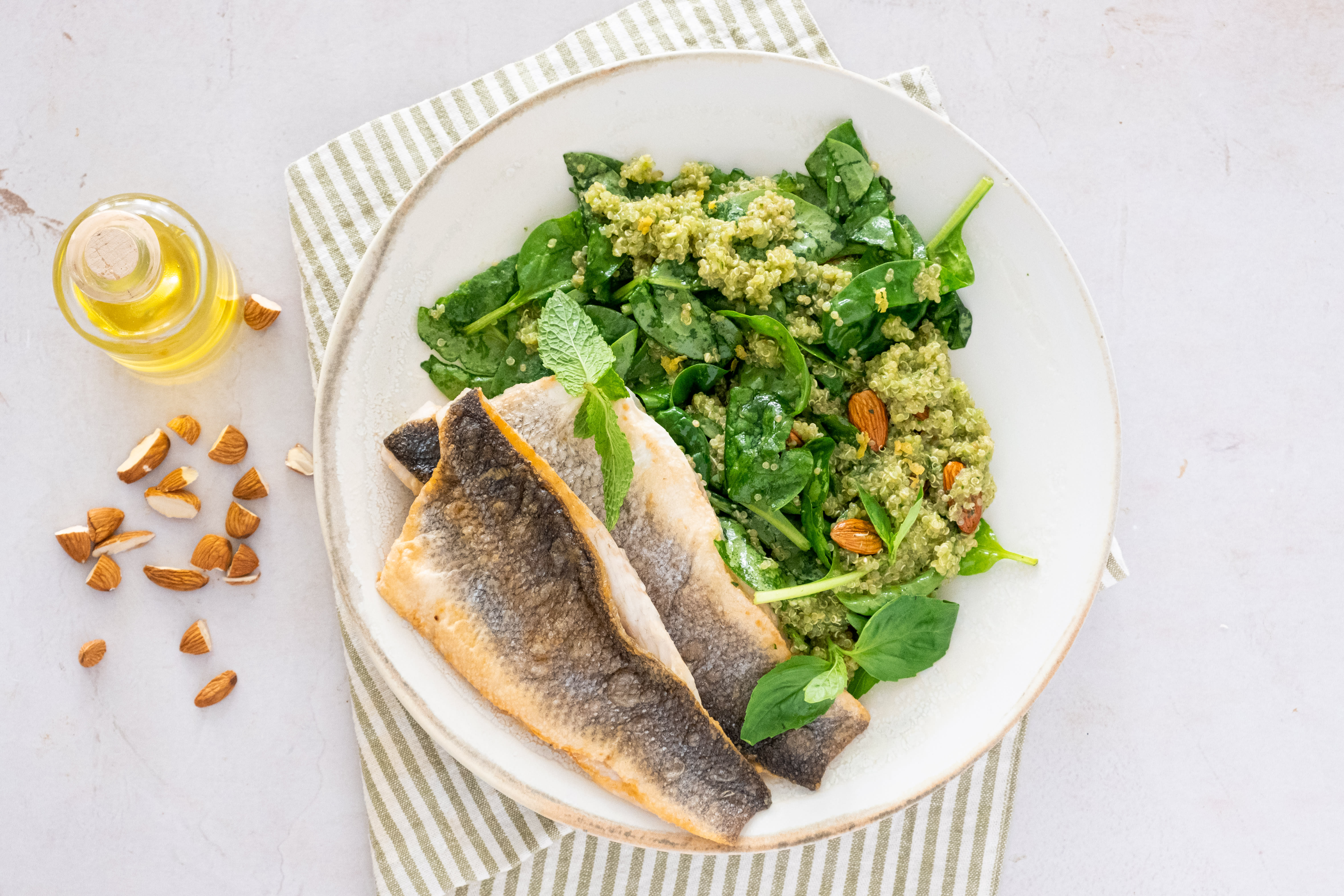 Mediterranean-style Seabass with Quinoa, Herb Dressing and Baby Spinach