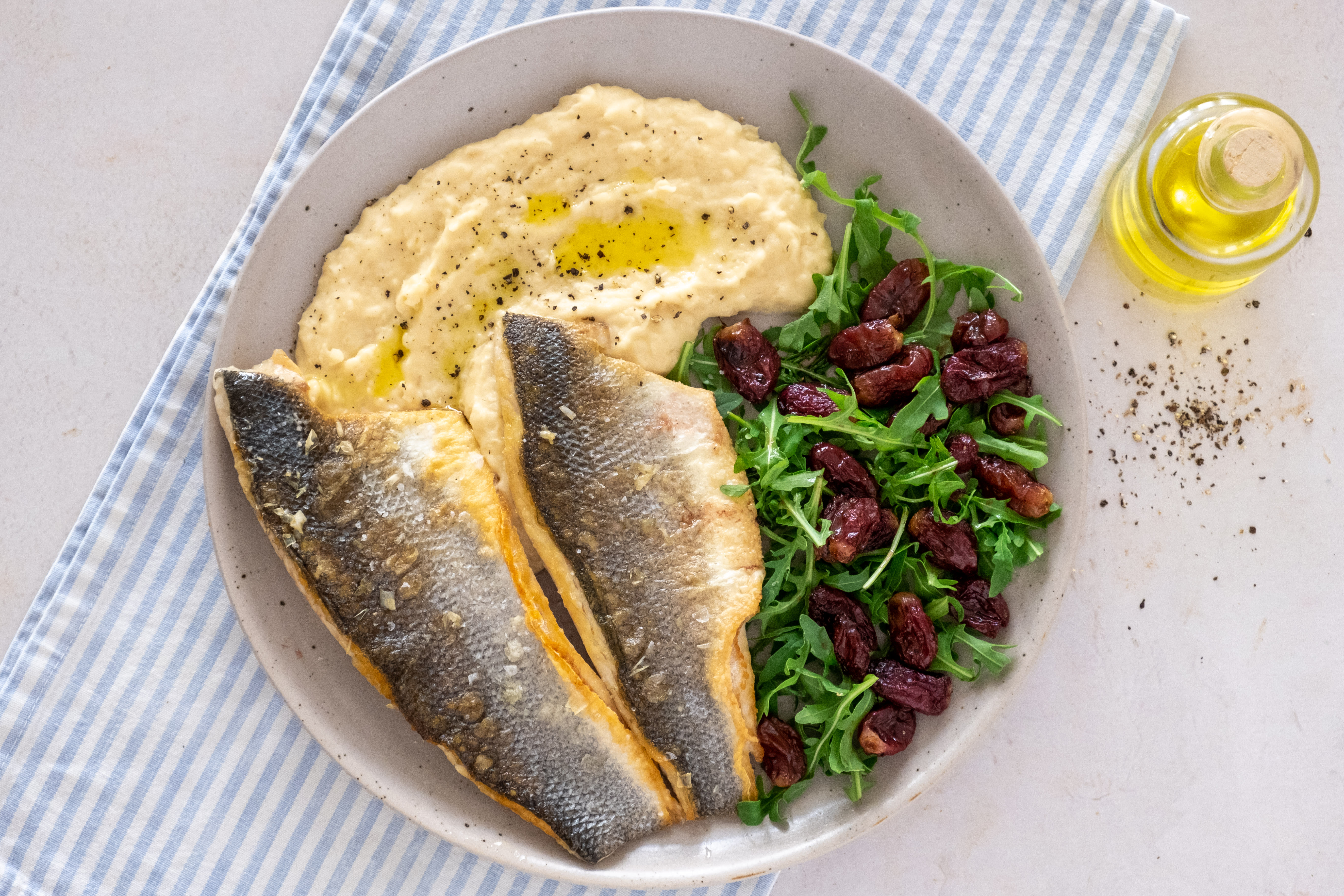 Mediterranean-style Seabass with White Bean Puree and Roasted Grape Salad