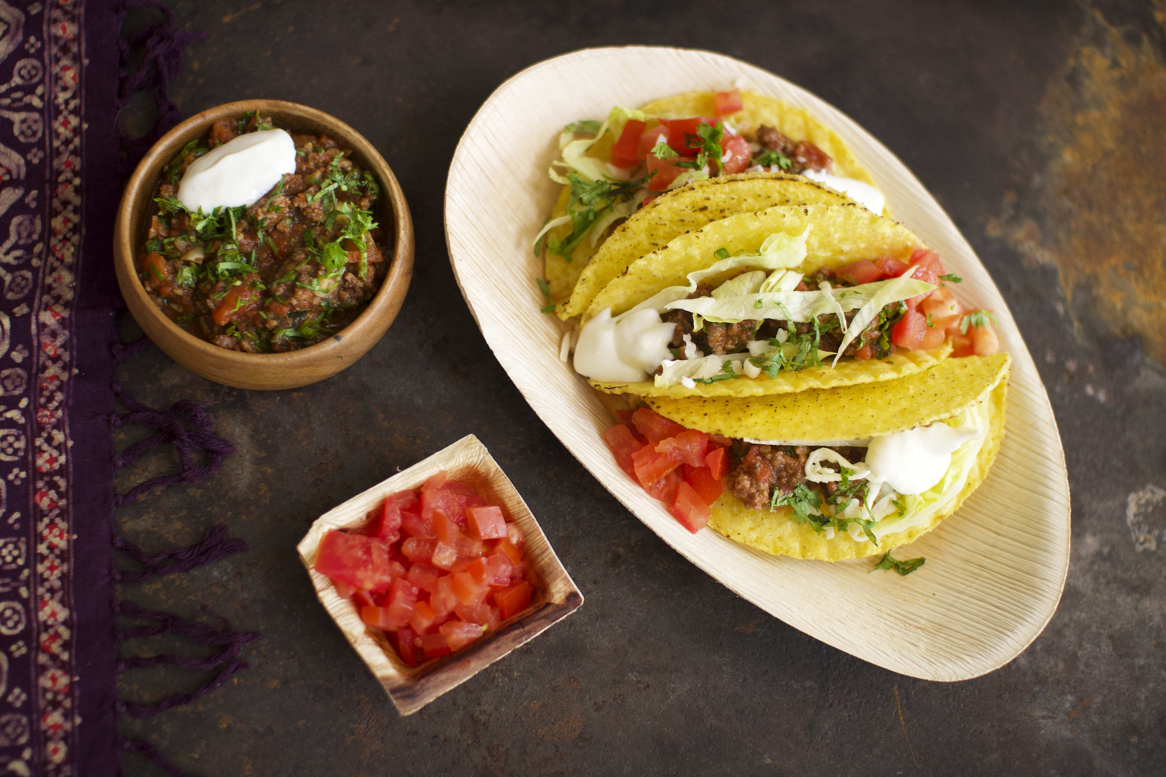 Crispy Beef Tacos with Lettuce, Tomato and Cheese