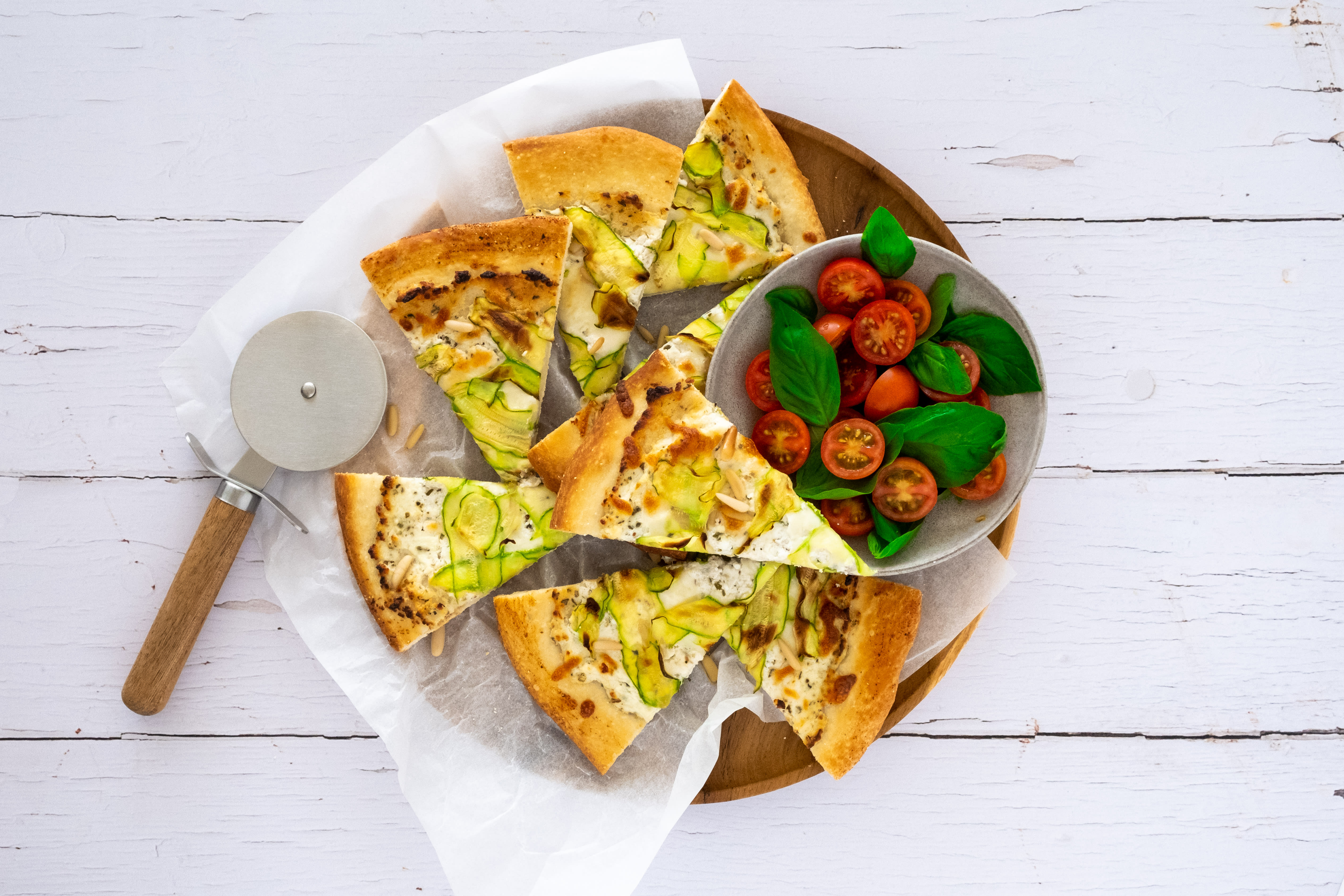 Ricotta and Zucchini Pizza with Pine Nuts and Tomato Salad