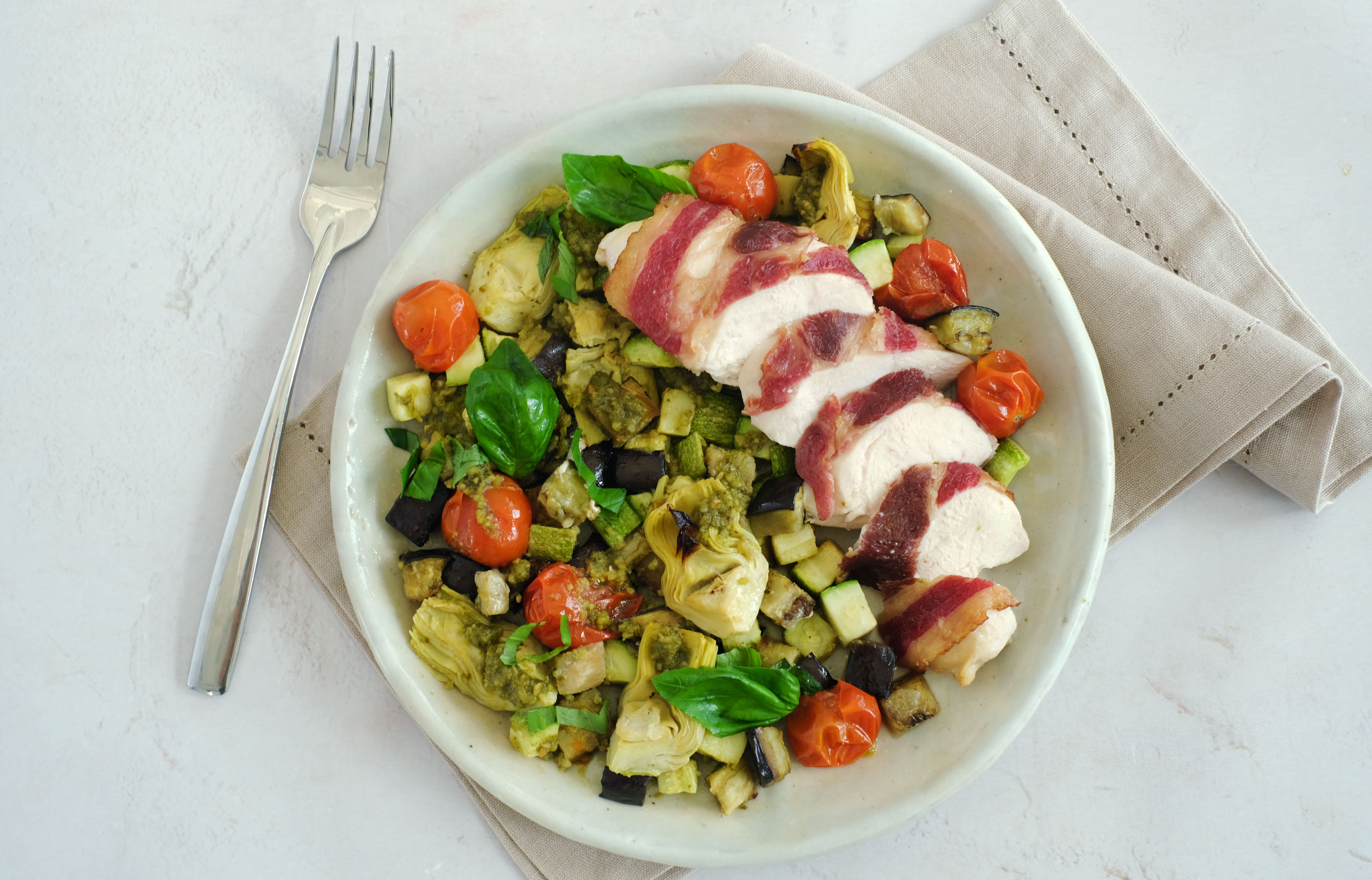 Bacon Wrapped Chicken with Warm Pesto Vegetables