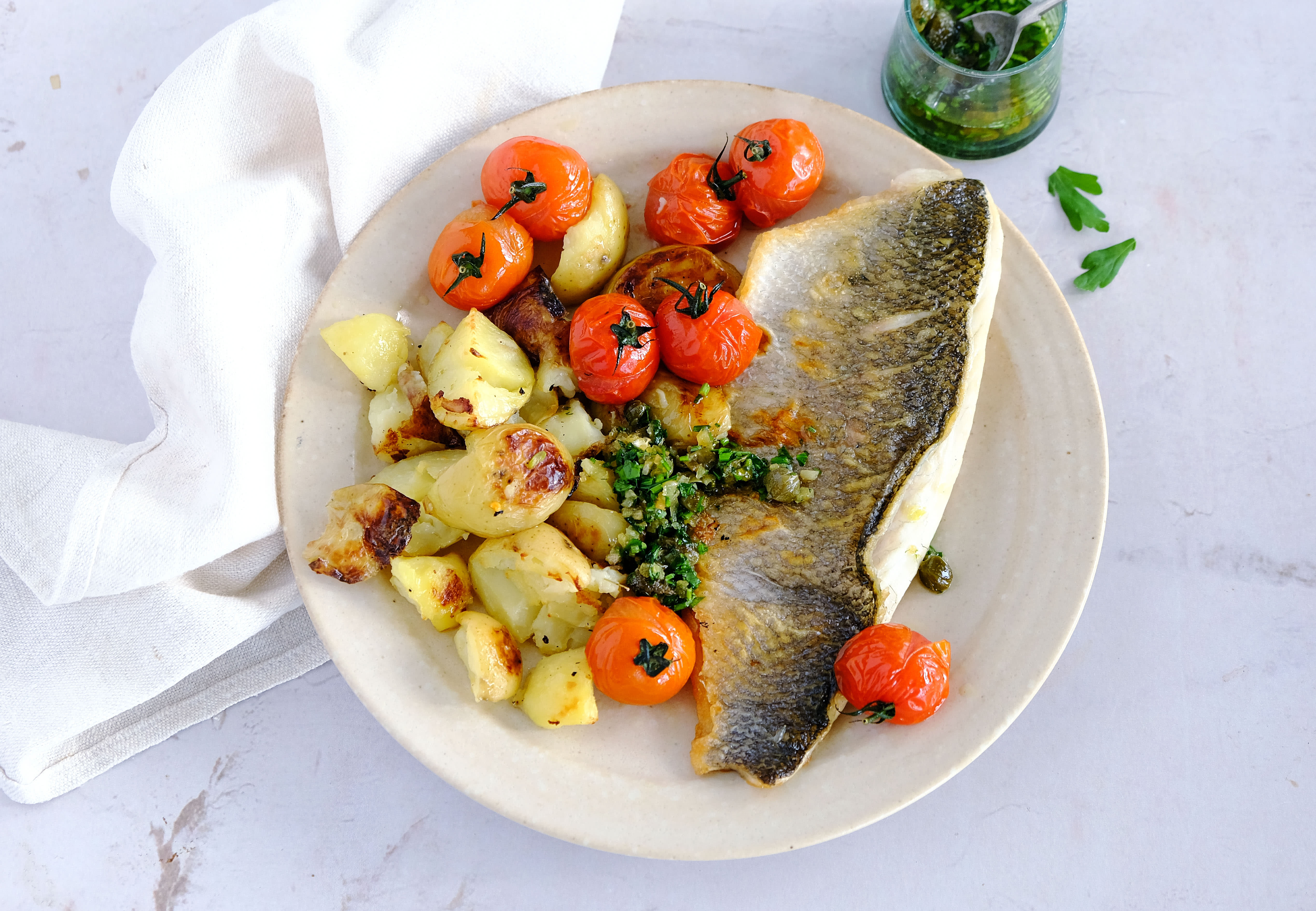 Sea Bass, Garlic Butter and Crushed Potatoes with Roasted Cherry Tomatoes
