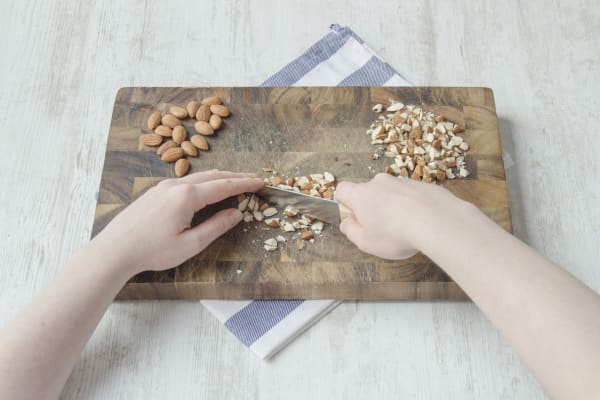 Chop the raw almonds