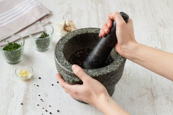 Crack the peppercorns in a pestle and mortar