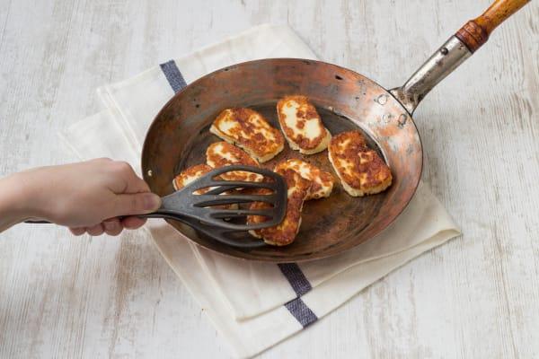 Fry the halloumi until golden
