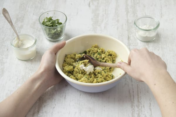 Mix in the flour, coriander, cheese and yoghurt