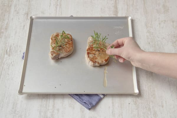 Scatter rosemary on top of the chops before putting them in the oven