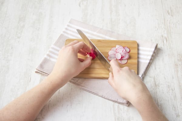 Thinly slice the radishes