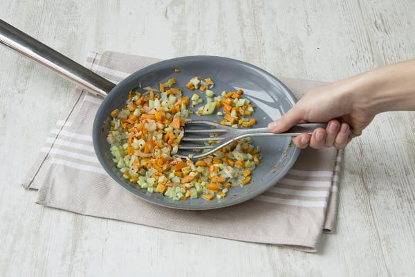 Fry chilli flakes, onion, garlic, celery and carrot