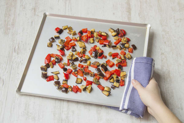 Put the aubergine and pepper on a baking tray