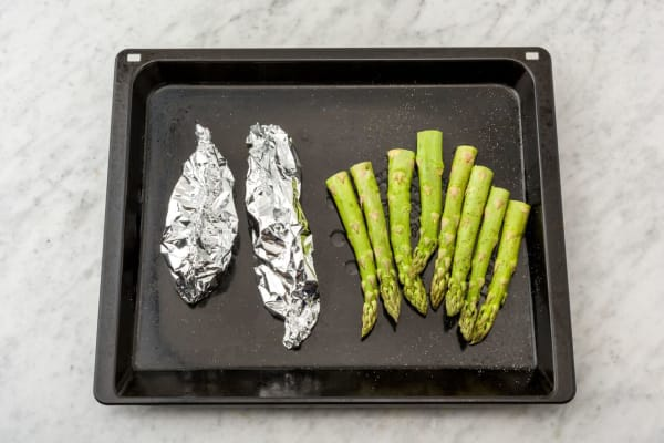 Cook the salmon and asparagus