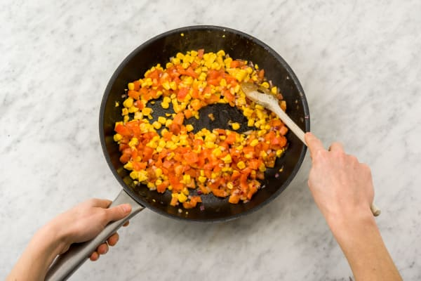 Cook the corn, tomato and red onion