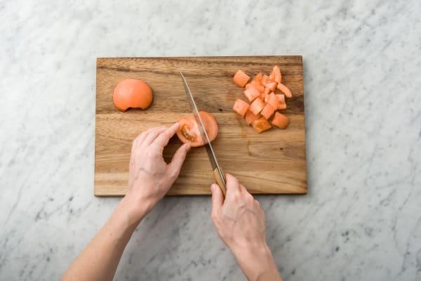 Score the skin of the tomato