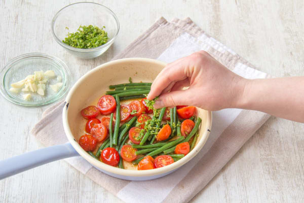 Sauté the tomatoes and green beans