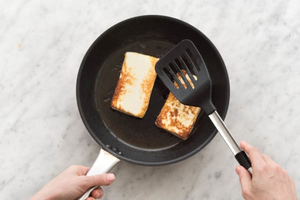 Cook Grilling Cheese