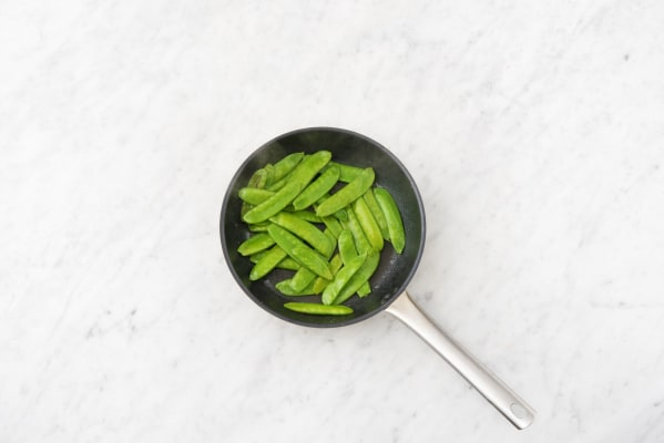Glaze the chicken and cook the snap peas