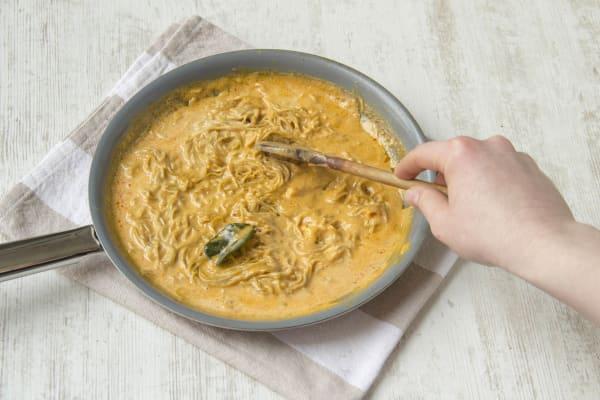 Cook egg noodles.