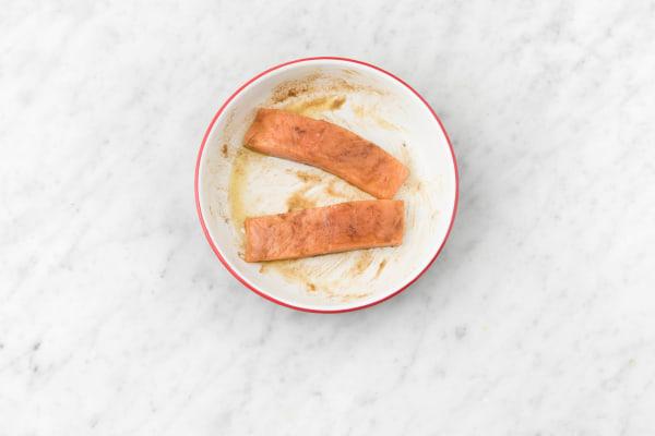 Marinate salmon.