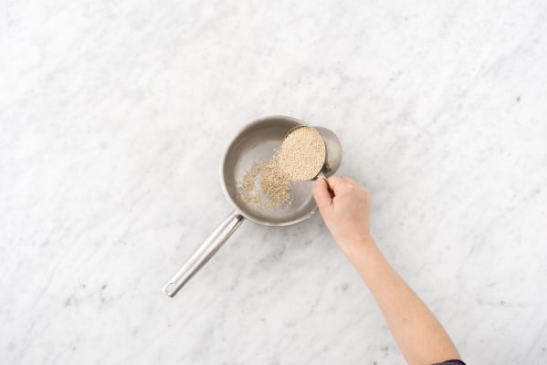Preheat the oven and cook the quinoa
