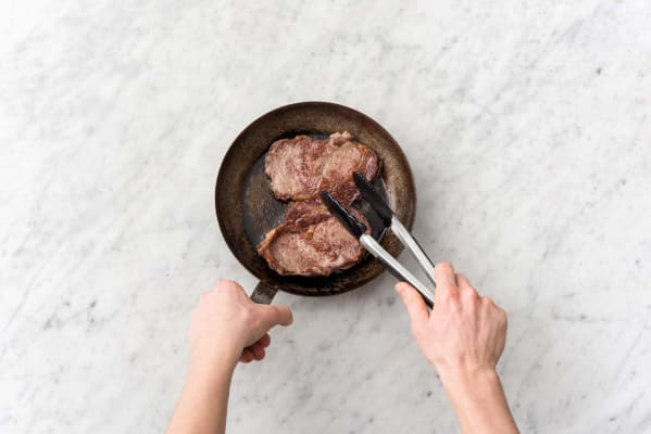 Cook the steak on each side