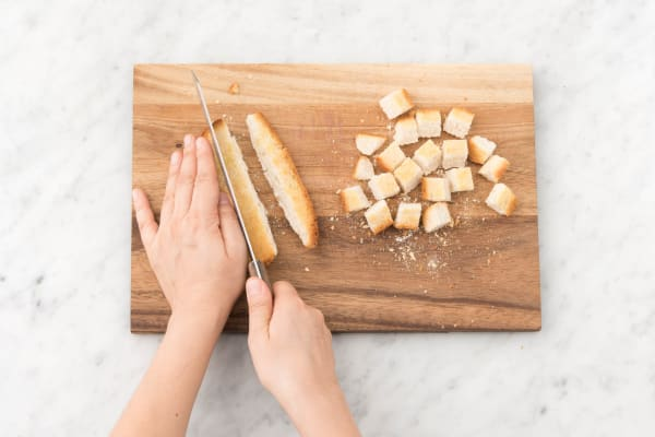 Slice the sourdough roll into 1 cm cubes