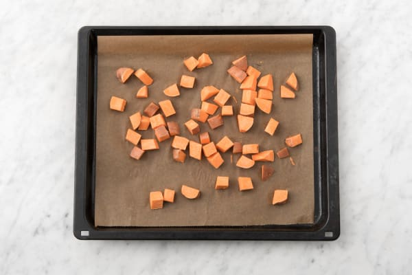 Preheat and roast sweet potatoes