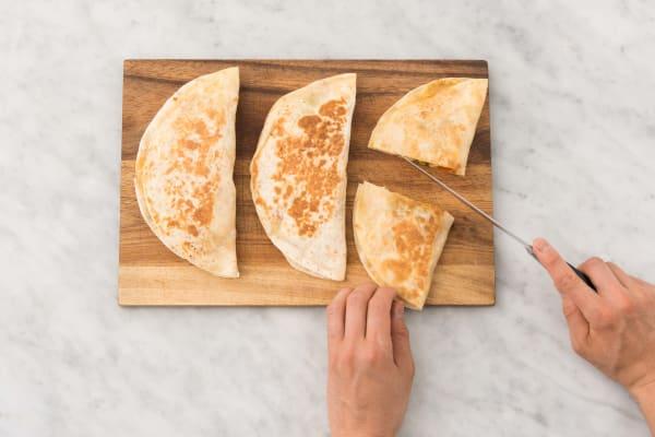 Cut the warm quesadillas into wedges