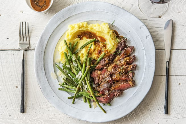 Strip Steak Over Truffled Mashed Potatoes